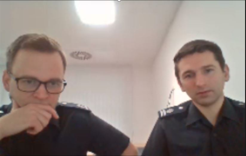 Two men looking at computer camera in an online meeting.
